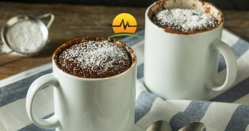 One minute protein brownie cooked in white mug. Memorial Advanced Surgery logo overlay