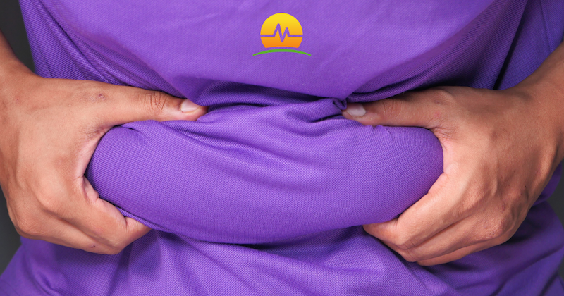 Male in Purple Shirt Grabbing Extra Stomach Weight