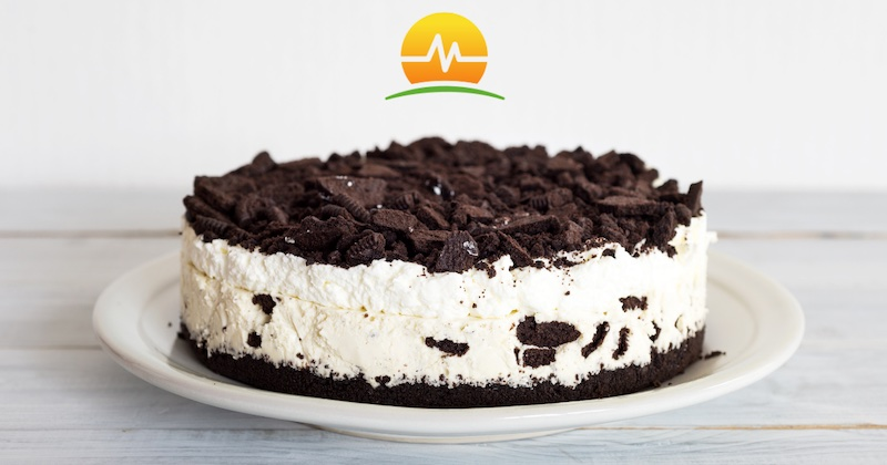 Cookies and cream cheesecake served on a white plate and wooden table. Memorial Advanced Surgery logo placed in top center of picture.
