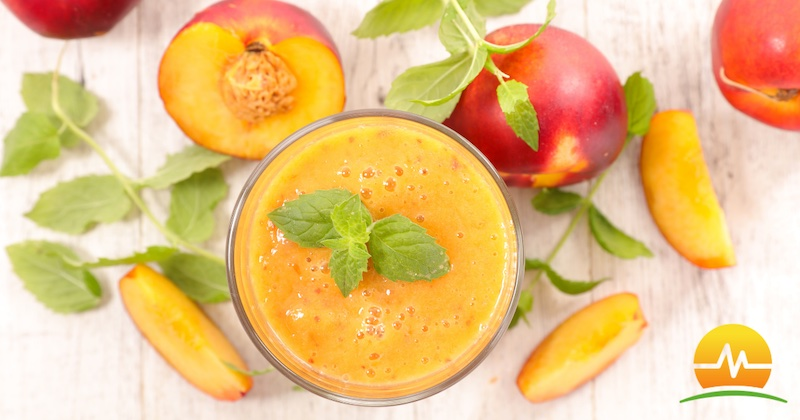 Healthy peach smoothie in center of picture surrounded by fresh peaches. Memorial Advanced Surgery logo placed in bottom right corner.