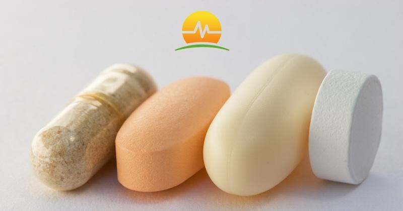 One white soft pill, an orange pill, and a brown pill